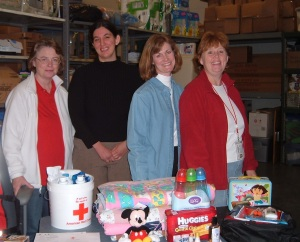 Bonnie Chapman (left - red shirt, white sweatshirt) with other members of the Disaster Team showing supplies given to families.