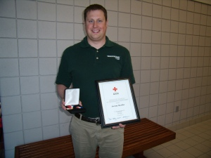 Jeremy Moeller, with his American Red Cross Lifesaving Award