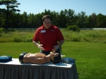 Peter Kretche, Volunteer Instructor, show the golfers how to use an Automated external defibrillator (AED).