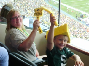 Val and her son JJ cheering on the Packers in a box seat donated by the Green Bay Packers.