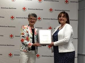 Dr. Joyce Keyes receives Heroes Award from WI First Lady Tonette Walker.