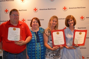 (l-r) Scott Vanidestine, Emergency Services Award, Judy Gregory, Disaster Director, Deb Harrington, Behind-the-Scenes Award, and Nancy Mirhashemi, Volunteer of the Year.