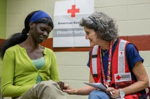 Monday, September 16, 2013. Red Cross shelter at the YMCA, Boulder, Colorado. Esther Peter, of Boulder, Colorado, shares her heroic story with Dr. Kathy Palakow, Psy.D., LPC, Red Cross Mental Health Worker of Boulder, CO. Photo by Hector Emanuel/American Red Cross