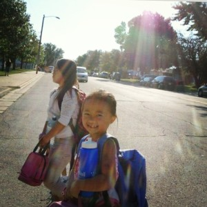 Nevaeh & Cienna crossing the street to school.
