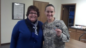 (l-r) Patty Flowers with Adrianne Benson holding the coin.