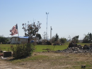 Some of the destruction in the Arkansas area, but the American Flag still stands.