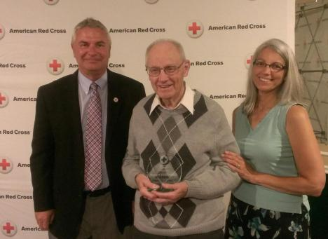 (l-r)  Greg Novinska, CEO, Badger-Hawkeye Blood Service Regioin, Robert Hollenbeck, Hilary Lesperance Award Winner, and his daughter, Lori Hollenbeck