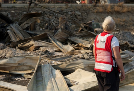 Disaster Mental Health Manager Diane Hermanson looks at damaged property from the Washington wildfires. The fires have forced people to leave their neighborhoods and more than 200 people have stayed in numerous Red Cross shelters since the fires started.