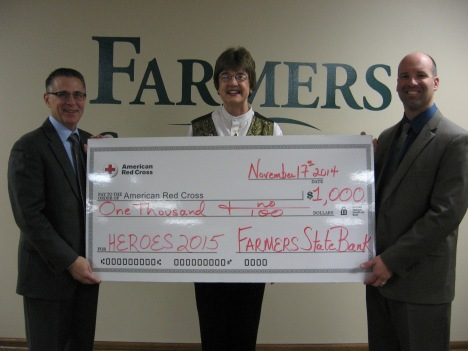 Shown left to right:  Laine Lazers, President, Farmers State Bank; Vicki P. Jenks, American Red Cross Board Member;  and Jay Krcmar, Vice President, Farmers State Bank.