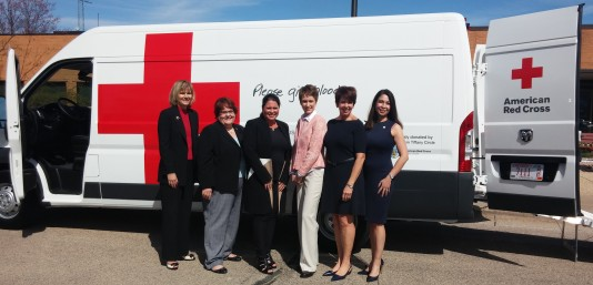 Tiffany Circle members Beth Anderson, Patty Flowers, Aymee Balison, Sara Horein, Marti Spittell Ziegelbauer and Lavina Harjani-Kuzuhara celebrate the new Blood Services van.